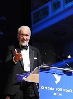 Actor Christopher Lee gives a speech during the 'Cinema For Peace 2009' charity gala at the 59th Berlinale film festival in Berlin February 9, 2009. Picture taken February 9, 2009. REUTERS/Jens Kalaene/Pool