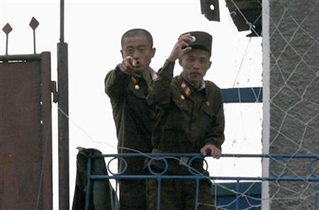North Korean soldiers guard the bank of the Yalu River near the Chongsong County of North Korea, opposite the Chinese border town of Hekou June 15, 2009. REUTERS/Jacky Chen