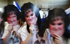 <p>Fans of television show 'Britains Got Talent' singer Susan Boyle pose for photographers holding masks in their local community centre in Blackburn, Scotland after watching a broadcast of Boyle performing on the final of the show May 30, 2009. REUTERS/ David Moir</p>