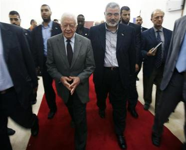 Senior Hamas leader Ismail Haniyeh (R) walks with former U.S. President Jimmy Carter after their meeting in Gaza City June 16, 2009. REUTERS/Suhaib Salem