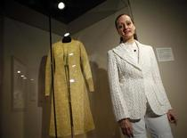 <p>Designer Isabel Toledo poses with the dress that first lady Michelle Obama wore on Inauguration day, in New York June 16, 2009. The dress is part of an exhibition by the designer at the Fashion Institute of Technology in Manhattan. REUTERS/Eric Thayer</p>