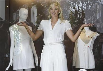 Russia's Maria Sharapova poses for the media as she promotes a new clothing collection at a Liberty boutique in London June 17, 2009. REUTERS/Stefan Wermuth