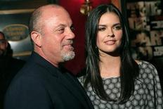 "<p>Billy Joel and his wife Katie Lee Joel arrive at the premiere of ""The Departed"" in New York, September 26, 2006. REUTERS/Eric Thayer</p>"