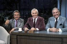 "<p>""The Tonight Show with Johnny Carson"" host Johnny Carson (C) poses with band leader Doc Severinsen (L)and sidekick Ed McMahon, in an undated photo. REUTERS/NBC/Handout</p>"