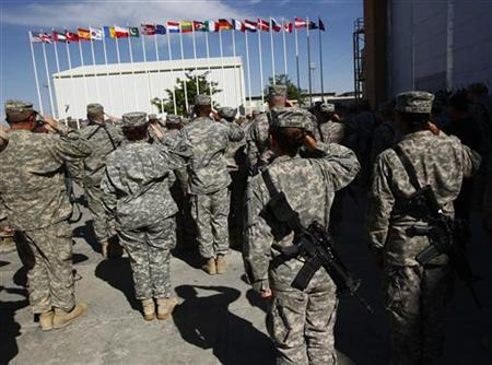 U.S. soldiers salute during a Memorial Day observance ceremony at the Bagram airbase, north of Kabul in this file photo from May 25, 2009. REUTERS/Ahmad Masood