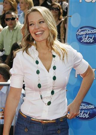 Actress Jeri Ryan poses as she arrives at the finale of the American Idol television show in Los Angeles, California May 21, 2008. REUTERS/Fred Prouser