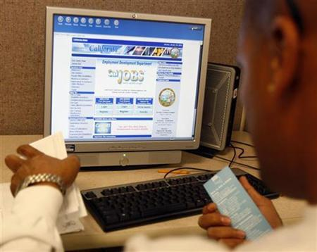 An unemployed man uses a computer at a job center in Los Angeles January 26, 2009. REUTERS/Lucy Nicholson