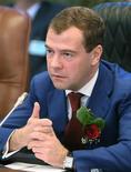 <p>Президент РФ Дмитрий Медведев выступает с речью во время своего визита в Намибию в Виндхуке 25 июня 2009 года. Госдума РФ одобрила в пятницу в первом чтении поправки президента Дмитрия Медведева, смягчающие закон о некоммерческих организациях. REUTERS/RIA Novosti/Kremlin/Mikhail Klimentyev</p>
