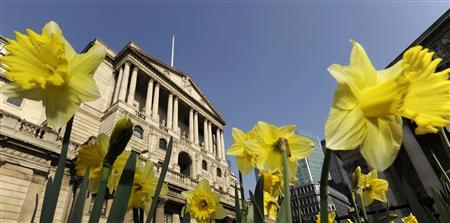 Daffodils in bloom adorn flowerbeds in front of the Bank of England in the City of London in a March 19, 2009 file photo. REUTERS/Toby Melville