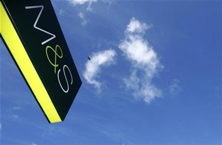 A Marks and Spencer sign is seen outside a branch of the store, in London on October 1, 2008. REUTERS/Luke MacGregor