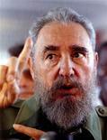 <p>Foto de archivo del ex líder cubano, Fidel Castro, tras una votación en La Habana, 24 feb 1993. El reggaetonero cubano Baby Lores, uno de los más famosos en la isla, abrirá este mes una gira por Europa con una canción dedicada a Fidel Castro y a su revolución de 1959. REUTERS/STR New</p>