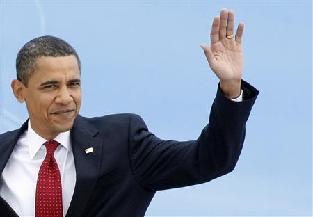 President Barack Obama waves on his arrival at Vnukovo airport outside Moscow, July 6, 2009. REUTERS/Denis Sinyakov