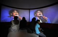 <p>Visitors watch a video of a performance at the Michael Jackson exhibit in the Grammy Museum in Los Angeles July 3, 2009. REUTERS/Phil McCarten</p>
