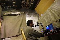 <p>DJ Ashiqullah works at the Garmsir radio station in Helmand province July 7, 2009. REUTERS/Ahmad Masood</p>