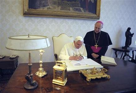Pope Benedict XVI signs his encyclical ''Charity in Truth'' at the Vatican July 6, 2009. REUTERS/Osservatore Romano