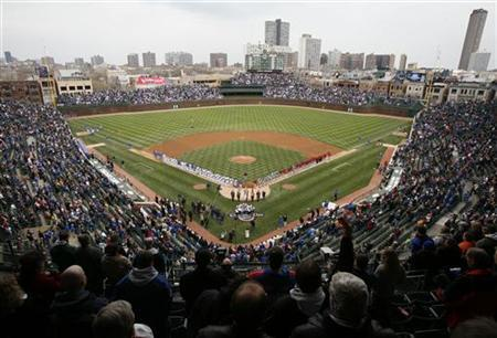 Chicago Cubs and Houston Astros stand during the national anthem before their opening day National League MLB baseball game at Wrigley Field in Chicago, April 9, 2007. REUTERS/John Gress