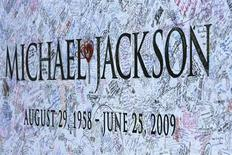 <p>A section of a large Michael Jackson poster is pictured outside Staples Center in Los Angeles July 6, 2009. The memorial for the pop star will be held at Staples Center in Los Angeles July 7. REUTERS/Mario Anzuoni</p>
