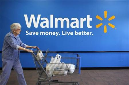 A customer leaves a Wal-Mart store in Rogers, Arkansas June 4, 2009. REUTERS/Jessica Rinaldi