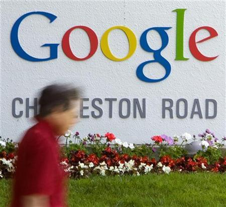 A man walks past Google Inc. headquarters in Mountain View, May 8, 2008. REUTERS/Kimberly White