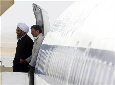 Iranian President Mahmoud Ahmadinejad arrives accompanied by a cleric for the opening of a petrochemical facility south of Tehran, June 25, 2009. REUTERS/Sajjad Safari/Mehr News