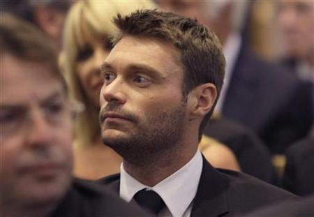Entertainer Ryan Seacrest attends the funeral for entertainer and producer Merv Griffin at the Good Shepherd Catholic Church in Beverly Hills, California August 17, 2007. REUTERS/Kevork Djansezian/Pool