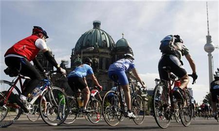 In this file photo participants ride their bicycles past the German cathedral (L) and the television tower (R) during a Velothon street race in Berlin May 25, 2008. A Berlin brothel has come up with a novel way to negate the impact of the global economic crisis and target a new group of customers at the same time -- offering a discount to patrons who arrive on bicycles. REUTERS/Fabrizio Bensch
