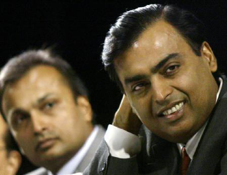 Mukesh (L) and Anil Ambani are seen at a meeting in Mumbai in this June 24, 2004 file photo. REUTERS/Arko Datta/Files