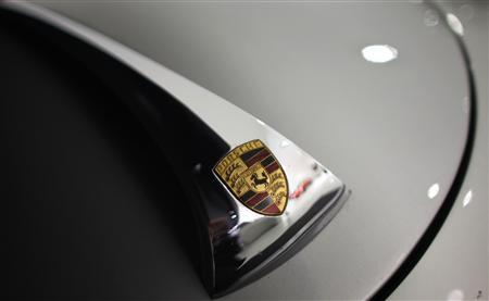 A Porsche logo is pictured on a bonnet of a car in the Porsche Museum in Stuttgart January July 22, 2009. REUTERS/Johannes Eisele