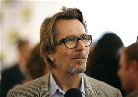 Cast member Gary Oldman attends a promotional event for the upcoming movie ''The Book of Eli'' during the 40th annual Comic Con Convention in San Diego July 24, 2009. REUTERS/Mario Anzuoni