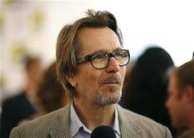 "<p>Cast member Gary Oldman attends a promotional event for the upcoming movie ""The Book of Eli"" during the 40th annual Comic Con Convention in San Diego July 24, 2009. REUTERS/Mario Anzuoni</p>"
