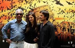 """<p>Gli attori Morgan Freeman, Katie Holmes e Christian Bale alla promozione di """"Batman Begins"""" a Roma nel 2005. REUTERS/Alessia Pierdomenico</p>"""