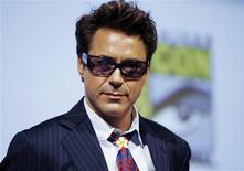<p>Actor Robert Downey Jr looks out at the crowd as he leaves a question and answer session following a short presentation of Iron Man 2 to the the thousands of attendees at this years annual Comic Con conference in San Diego, California July 24, 2009. REUTERS/Mike Blake</p>