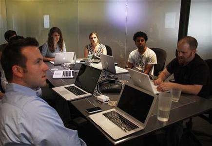 Socialight founder Dan Melinger and his team are pictured in a meeting in their New York office on July 14, 2009. REUTERS/Jamie Fine
