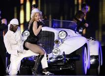 <p>U.S. singer Madonna performs during her Sticky and Sweet tour at Lluis Companys stadium in Barcelona July 21, 2009. REUTERS/Albert Gea</p>