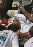 <p>Foto de arquivo do piloto da Ferrari de Fórmula 1 Felipe Massa após acidente em treino na Hungria. 25/07/2009. REUTERS</p>