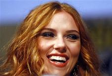<p>Scarlett Johansson smiles during the presentation of Iron Man 2 at the annual Comic Con conference in San Diego, California July 25, 2009. REUTERS/Mike Blake</p>