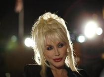 "<p>Composer and lyricist Dolly Parton attends the party following the opening night of ""9 to 5: The Musical"" in Los Angeles September 20, 2008. REUTERS/Mario Anzuoni</p>"