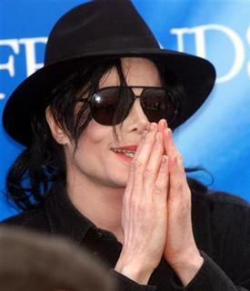 Pop star Michael Jackson gestures during a news conference in Munich's Olympic stadium in this June 9, 1999 file photo. REUTERS/Michael Kappeler/Files