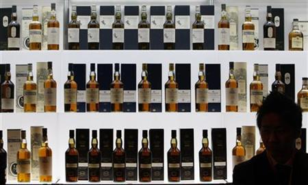 Bottles of malt whisky are displayed at a whiskey merchandising event in Tokyo February 10, 2008. REUTERS/Issei Kato