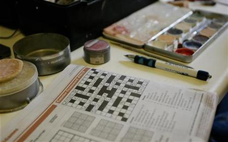 A newspaper with a half-completed crossword is seen in the dressing room of actor Tim Treslove before a performance of ''Dick Whittington and the Pi-rats of the Caribbean'' at the Mercury Theatre in the town of Colchester in England December 18, 2008. REUTERS/Simon Newman