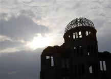 <p>The gutted Atomic Bomb Dome is silhouetted in Hiroshima, western Japan August 5, 2009. REUTERS/Issei Kato</p>