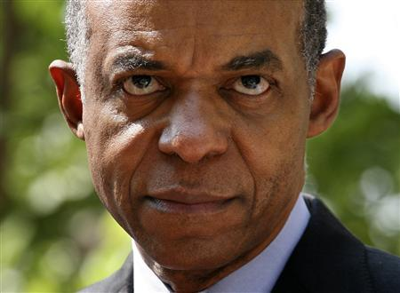 Then U.S. Rep. William Jefferson talks to the press while leaving U.S. District Court for the Eastern District of Virginia after arraignment proceedings against him in Alexandria, Virginia, in this June 8, 2007 file photo. REUTERS/Yuri Gripas/files