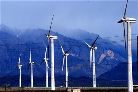 Wind turbines that produce electricity spin at a wind farm in Daban, in northwest China's Xinjiang Uygur Autonomous Region, March 1, 2005. REUTERS/File