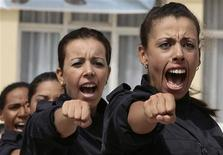 <p>Female police cadets perform during their graduation ceremony at the police academy in Ain Benian August 6, 2009. REUTERS/Zohra Bensemra</p>