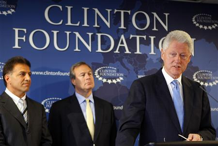 Former President Bill Clinton (R) speaks at a news conference with Robert J. Coury, Chairman and Chief Executive of Mylan (L) and Jeffrey B. Kindler, Chairman and Chief Executive of Pfizer (C), in New York, August 6, 2009. REUTERS/Chip East