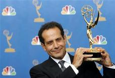 "<p>Actor Tony Shalhoub poses after winning an Emmy for outstanding lead actor in a comedy series for his work on ""Monk"" during the 58th annual Primetime Emmy Awards at the Shrine Auditorium in Los Angeles August 27, 2006. REUTERS/Mario Anzuoni</p>"