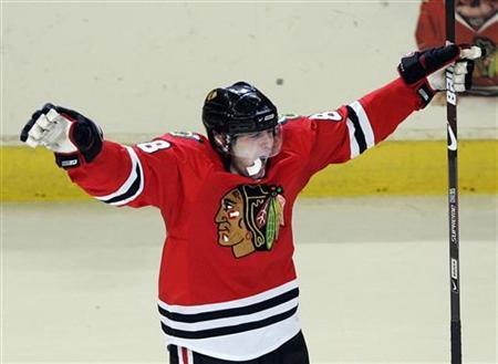 Chicago Blackhawks' Patrick Kane celebrates his third goal of the game on the Vancouver Canucks during the third period in Game 6 of their NHL Western conference semi-final hockey playoff in Chicago, May 11, 2009. REUTERS/Frank Polich