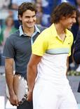 <p>O tenista número um do mundo e novo papai Roger Federer deve reacender sua rivalidade com Rafael Nadal no Masters de Montreal na semana que vem, quando o suíço busca seu terceiro triunfo consecutivo no evento canadense. REUTERS/Susana Vera</p>
