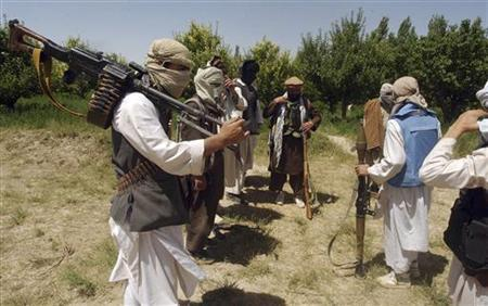 Taliban fighters are seen in an undisclosed location in Afghanistan July 14, 2009. REUTERS/Stringer (AFGHANISTAN CONFLICT MILITARY POLITICS)