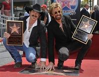<p>Kix Brooks (L) and Ronnie Dunn, of music duo Brooks and Dunn, pose after receiving a star on the Hollywood Walk of Fame August 4, 2008. REUTERS/Phil McCarten</p>